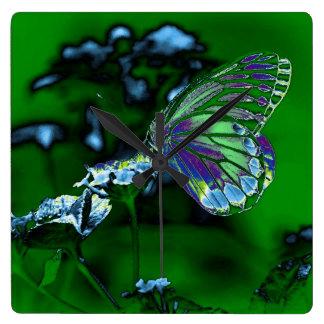 Mariposa en la flor - foto negativa reloj cuadrado