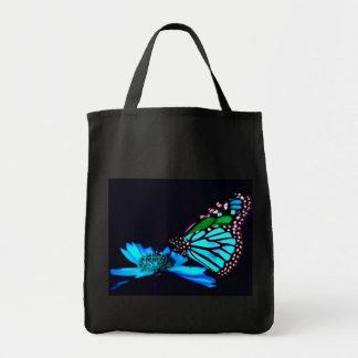 Mariposa en luz azul bolsa tela para la compra
