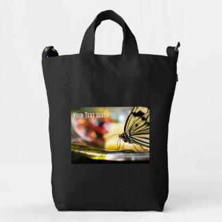 Mariposa en un plato bolsa de lona duck