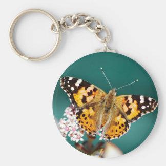 Mariposa en una brizna llavero