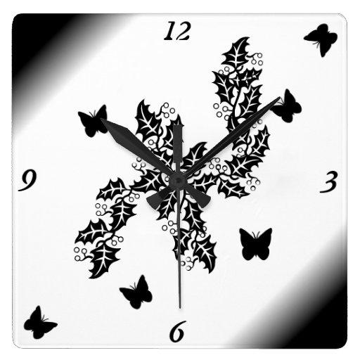 mariposa negra en blanco y negro reloj cuadrado