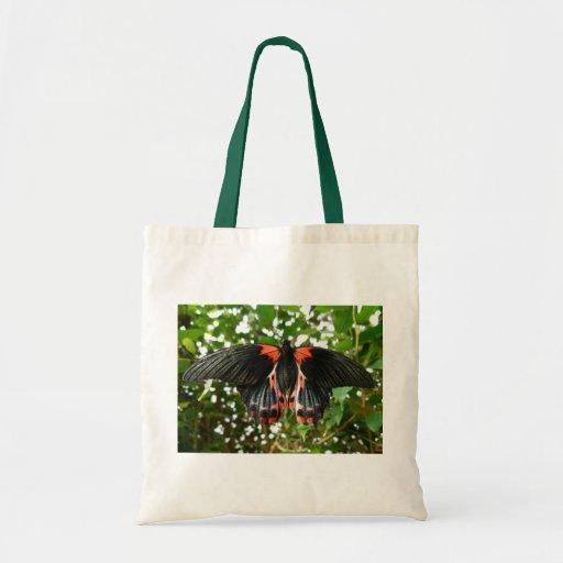 Mariposa negra y roja bolsas