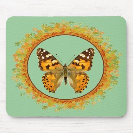 Mariposa pintada aislada de la señora en el marco  alfombrilla de ratones