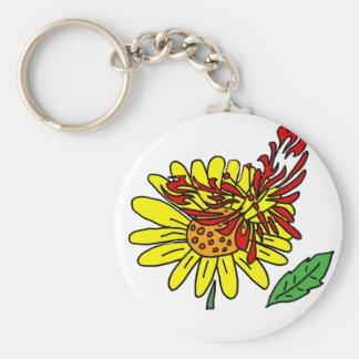 Mariposa roja artística en la flor amarilla de la llavero redondo tipo pin