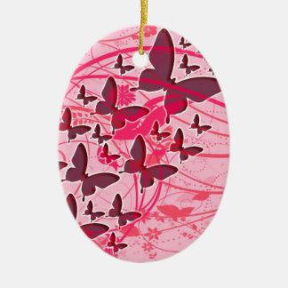 Mariposa rosada adorno navideño ovalado de cerámica