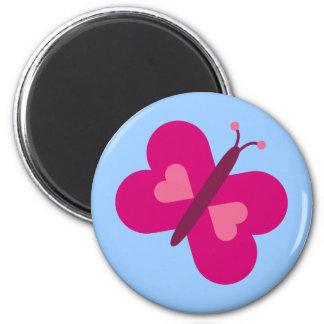 Mariposa rosada bonita con el imán del azul de los