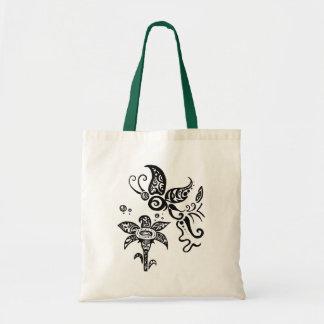 Mariposa tribal blanco y negro bolsas
