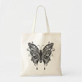 Mariposa tribal negra y blanca del estilo bolsas
