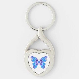 Mariposa veteada azul en llavero en forma de llavero plateado en forma de corazón