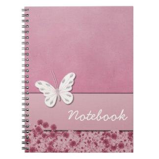 Mariposa y cuaderno de las flores