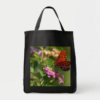 Mariposa y flores bolsa