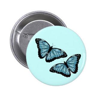Mariposas azules artsy pin redondo de 2 pulgadas