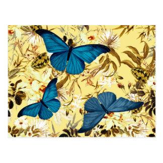 Mariposas azules en estampado de flores de la postales