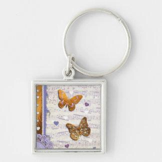 Mariposas bonitas de la púrpura y del oro y collag llavero cuadrado plateado