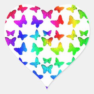 Mariposas brillantes del remolino del arco iris pegatina en forma de corazón