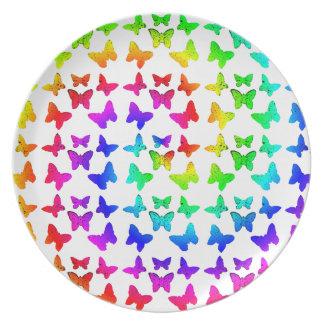 Mariposas brillantes del remolino del arco iris platos