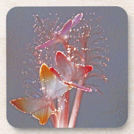 Mariposas de la fibra óptica que brillan intensame posavaso