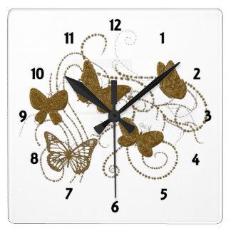 Mariposas de oro con remolinos de oro relojes de pared