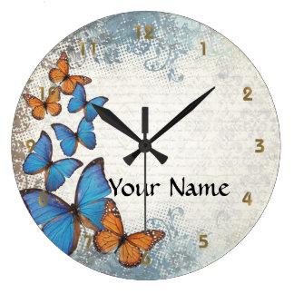 Mariposas florales azules reloj redondo grande