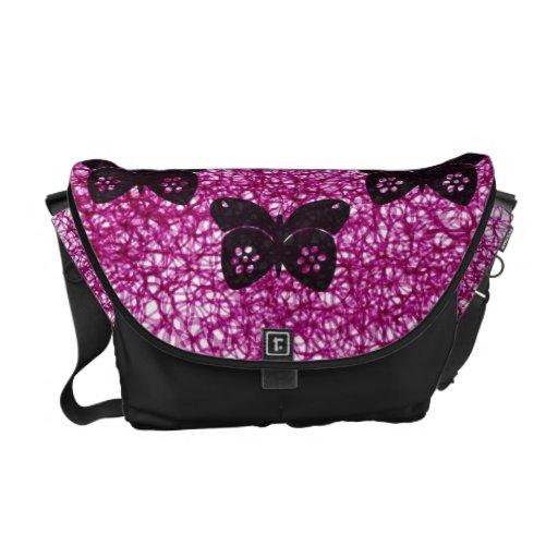 Mariposas negras en remolinos bolsas de mensajeria