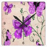 Mariposas púrpuras en colores pastel reloj de pared