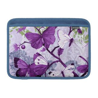 Mariposas púrpuras en ramas fundas macbook air