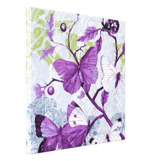 Mariposas púrpuras en una rama impresiones en lona estiradas