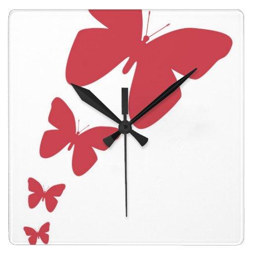 Mariposas que agitan - en baya ruborícese reloj cuadrado