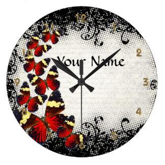 Mariposas rojas en cordón negro reloj redondo grande
