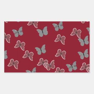 Mariposas rojas pegatina rectangular