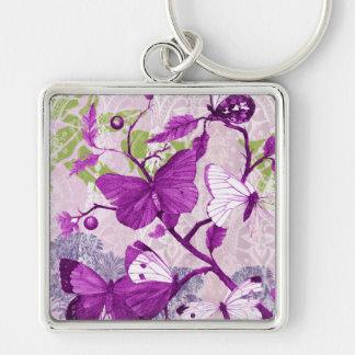 Mariposas violetas en una rama llavero cuadrado plateado