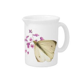 Mariposas y flores jarra para bebida