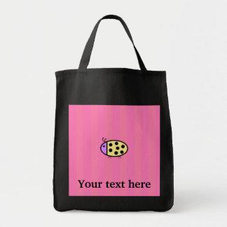 Mariquita amarilla con las rayas rosadas bolsa tela para la compra