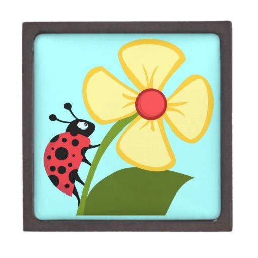 Mariquita y flor amarilla cajas de recuerdo de calidad