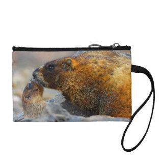 marmot and baby change purses