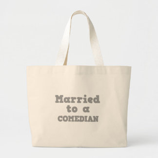 MARRIED TO A COMEDIAN TOTE BAGS