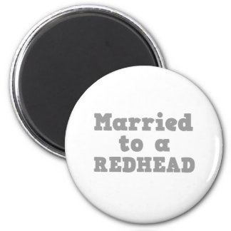 MARRIED TO A REDHEAD 2 INCH ROUND MAGNET