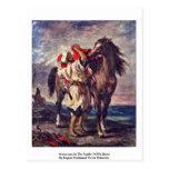 Marroquíes en la silla de montar de su caballo postal