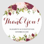 """Marsala Pink Floral Wedding Thank You Classic Round Sticker<br><div class=""""desc"""">This &quot;Thank You&quot; sticker for your wedding favors features marsala script lettering bordered by floral arrangements of marsala and pink flowers. Customize with names of bride and groom and the date of the wedding.</div>"""
