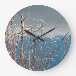 Marsh grass by the edge of a pond large clock