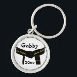 """Martial Arts 1st Degree Black Belt Keychain<br><div class=""""desc"""">Customize the Martial Arts 1st Degree Black Belt Keychain with the personal name of your martial artist and the earned they earned a first degree black belt. This personalized martial arts key ring features a blackbelt design with one gold bar or stripe and a white background. Suitable for all martial...</div>"""