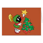 Marvin the Martian putting star on tree Greeting Cards
