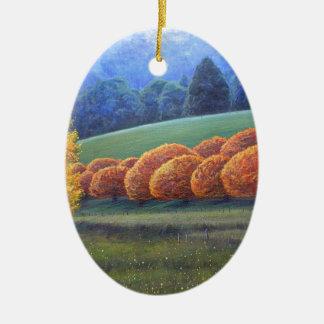 Marzo de robles brillantes adorno navideño ovalado de cerámica
