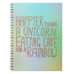 Más feliz que un unicornio que come la torta en un libros de apuntes