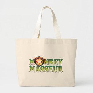 Masajista del mono bolsas lienzo