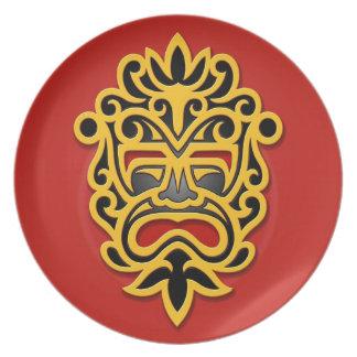 Máscara azteca amarilla plato de cena
