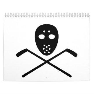 Máscara cruzada de los palillos de hockey calendario