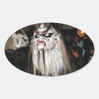 Máscara japonesa de cuernos del diablo pegatina ovalada