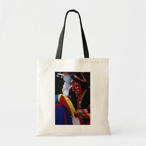 Masked dance tote bags