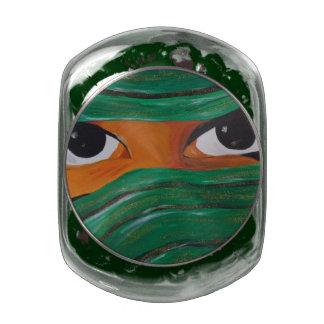 Masked woman in dark green glass jar
